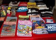 Lots of magazines, T-shirts and other goodies for sale at the Matra booth