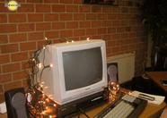 Wolf_ covers his monitor in christmas lighting, even in summer.