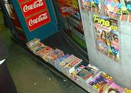 Erotic magazines and Coca Cola for sale.
