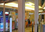 An internet cafe and a karaoke bar.