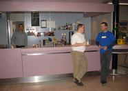 Finished building up the fair: time for coffee! On the left: Frans, the bar man of the day