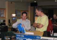 Bas Kornalijnslijper showing Remy van den Bor what's inside that big Toshiba HX-MU901 box: a Toshiba HX-MU900 FM Sound Synthesizer Unit!