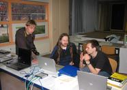 Part of the openMSX booth: Joost Damad, Maarten ter Huurne, Wouter Vermaelen