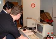 Koen Dols is demonstrating the Futuredisk interface to Mr. Nishi