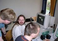 Maarten ter Huurne and Manuel Bilderbeek faking an interesting discussion about the openmsx emulator
